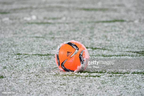Match ball is seen covered in snow during the Bundesliga match between Hertha BSC and TSG Hoffenheim on November 22 2015 in Berlin Germany