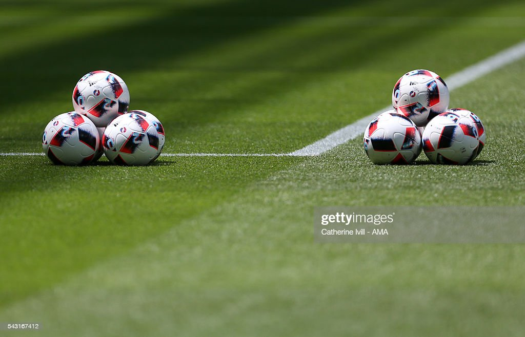 Match balls are piled up on the pitch before the UEFA EURO 2016 Round of 16 match between France and Republic of Ireland at Stade des Lumieres on June 26, 2016 in Lyon, France.