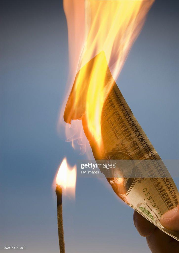 Match burning American dollar : Stock Photo