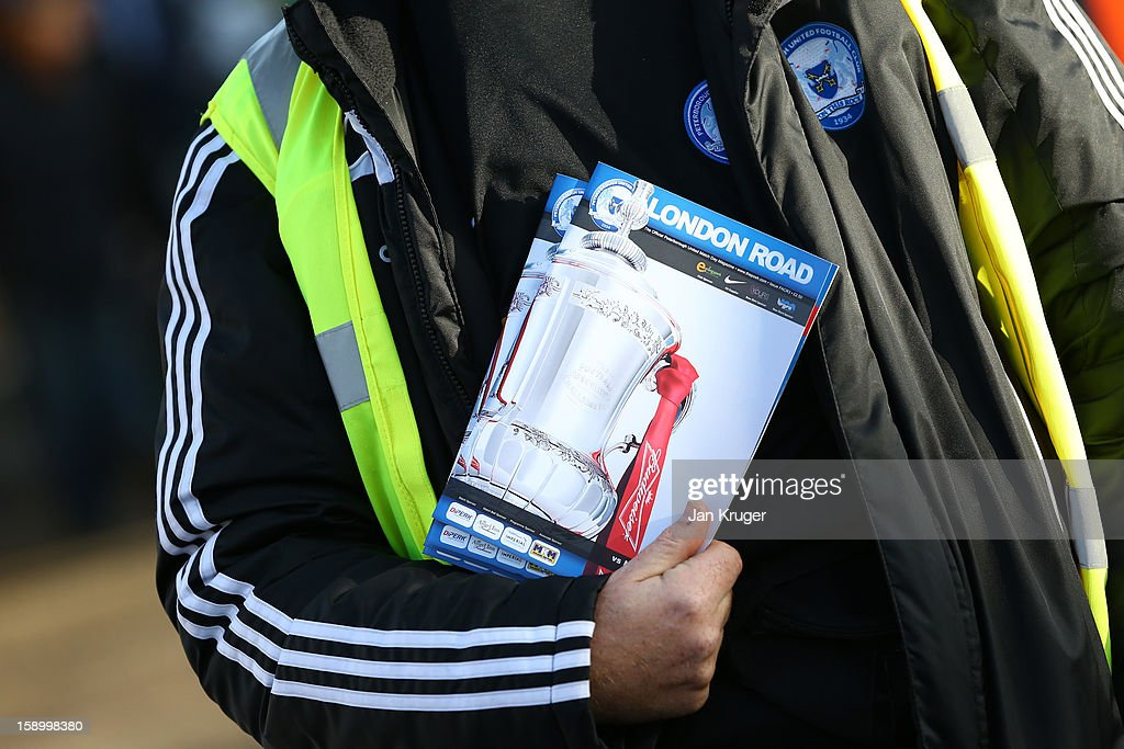 A match day programme seller is seen ahead of the FA Cup with Budweiser third round match between Peterborough United and Norwich City at London Road Stadium on January 5, 2013 in Peterborough, England.