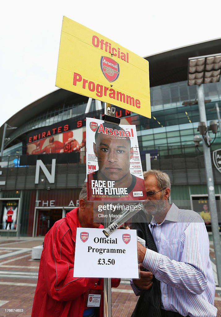Match day programmes for sale outside the ground prior to the Barclays Premier League match between Arsenal and Aston Villa at Emirates Stadium on August 17, 2013 in London, England.