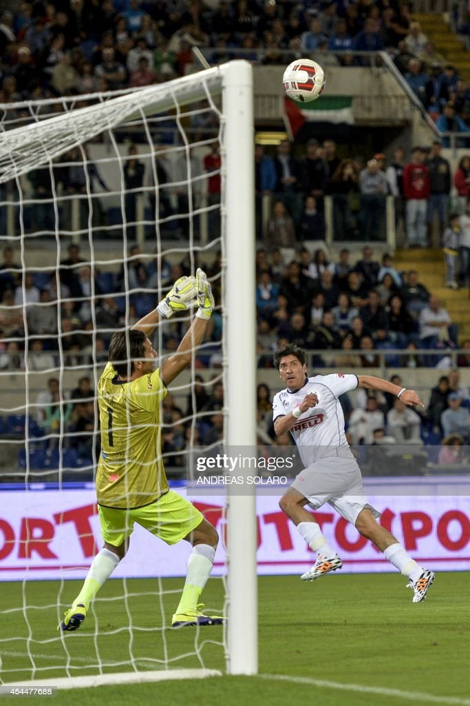 Match For Peace's Chilean midfielder Ivan Zamorano (L white) shoots the ball against Match For Peace's Italian goalkeeper Gianluigi Buffon during their intereligious ' Match for Peace ' football game on September 1, 2014 at Rome's Olympic stadium.
