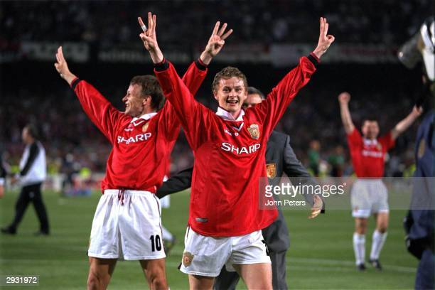 Match goalscorers Teddy Sheringham and Ole Gunnar Solskjaer of Manchester United celebrate with a treble salute after the UEFA Champions League Final...