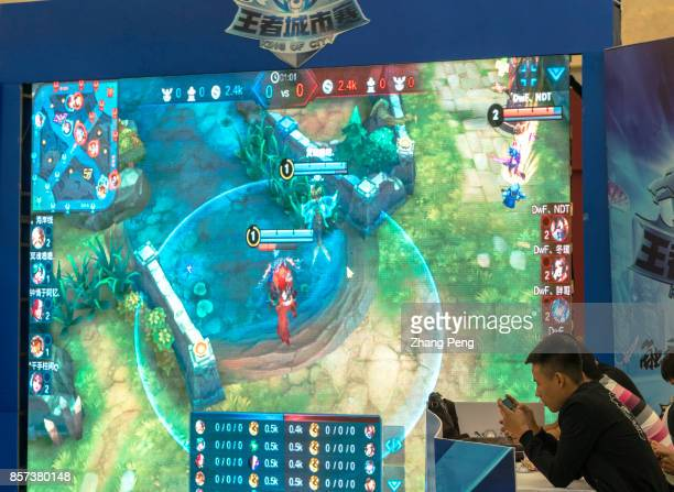 A match of the mobile game named Arena of Valor are held in a shopping mall Arena of Valor 5v5 Arena Game China's most popular mobile game developed...