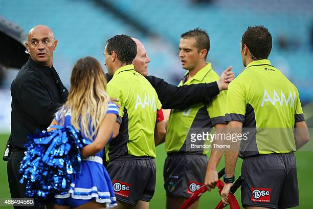 Match officals are escorted by security off the field during the round five NRL match between the Canterbury Bulldogs and the South Sydney Rabbitohs...