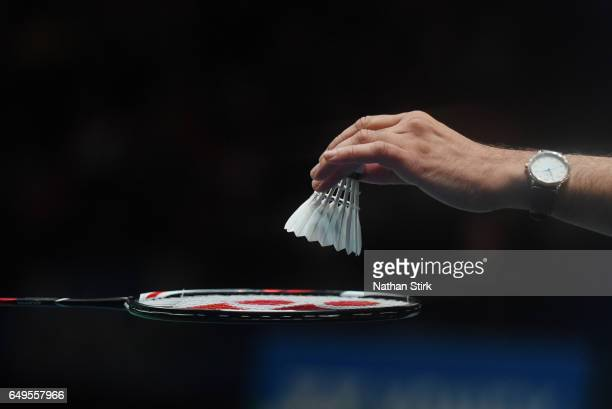 A match official places a new shuttlecock on a racket during day two of YONEX All England Open Badminton Championships at Birmingham Barclaycard...