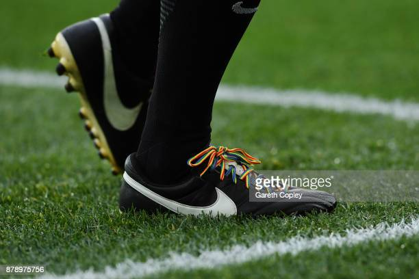 Match official wears rainbow laces during the Premier League match between Manchester United and Brighton and Hove Albion at Old Trafford on November...