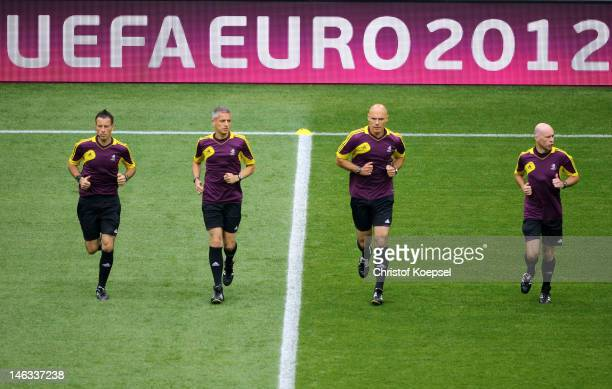 Match officials additional assistant referee Mark Clattenburg and assistant Peter Kirkup referee Howard Webb assistant referee Michael Mullarkey warm...