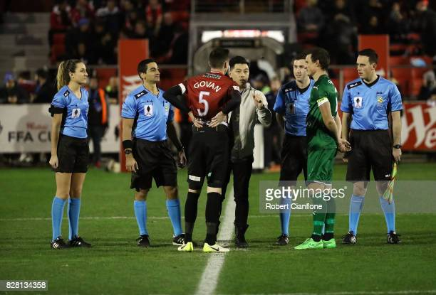 Match officials are seen at the coin toss during the FFA Cup round of 32 match between Hume City FC and Bentleigh Greens at John Iilhan Memorial...