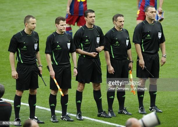 Match Officials including referee Viktor Kassai