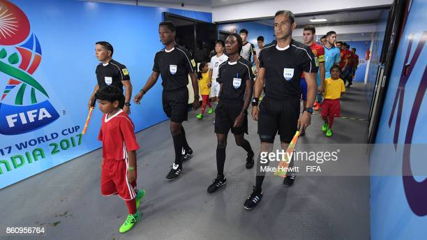 Match officials lead the teams out for the FIFA U17 World Cup India 2017 group D match between Spain and Korea DPR at the Jawaharlal Nehru...