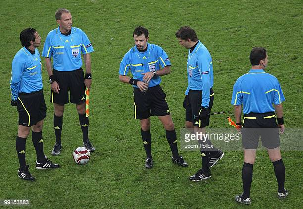 Match officials stand together during the UEFA Europa League final match between Atletico Madrid and Fulham at HSH Nordbank Arena on May 11 2010 in...