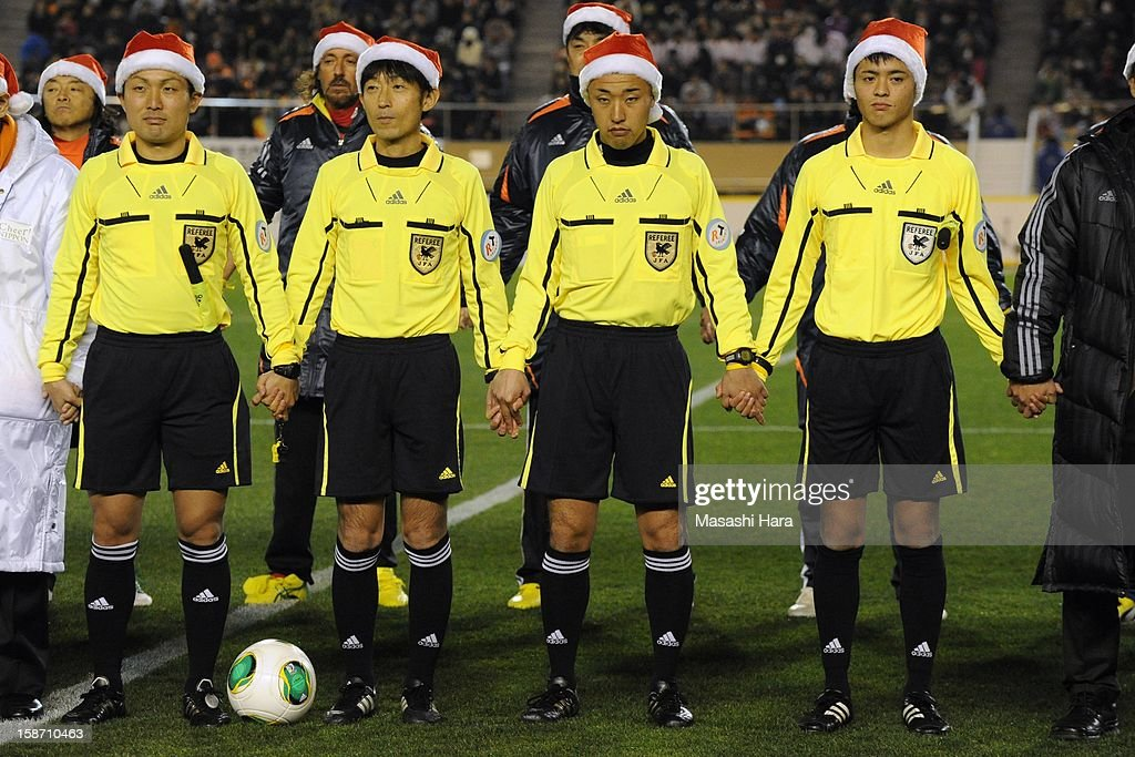 Match officials wear Christmas hats as they look on prior to the Great East Japan Earthquake charity match 'SAWA and Friends, X'mas Night 2012' at the National Stadium on December 25, 2012 in Tokyo, Japan.