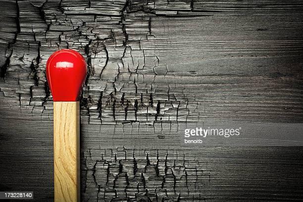 Match on burnt wood