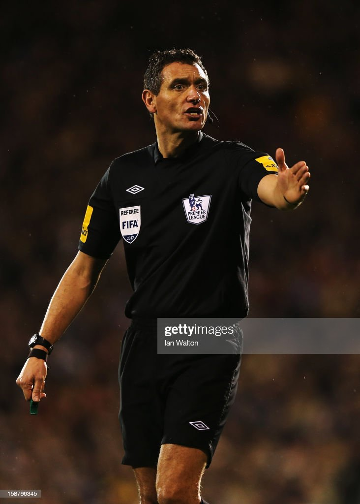 Match referee Andre Marriner is seen during the Barclays Premier League match between Fulham and Swansea City at Craven Cottage on December 29, 2012 in London, England.