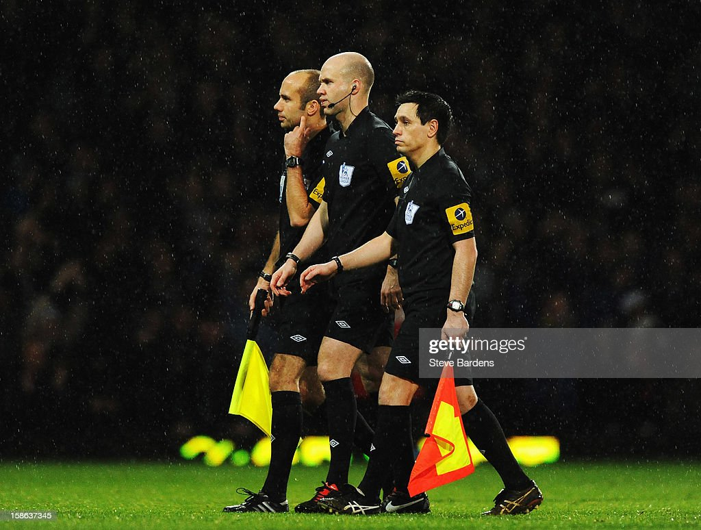 Match referee Anthony Taylor walks off flanked by his assitants following the Barclays Premier League match between West Ham United and Everton at the Boleyn Ground on December 22, 2012 in London, England.