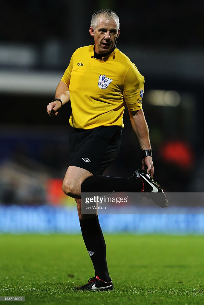 Match referee Chris Foy is seen during the Barclays Premier League match between Queens Park Rangers and West Bromwich Albion at Loftus Road on December 26, 2012 in London, England.