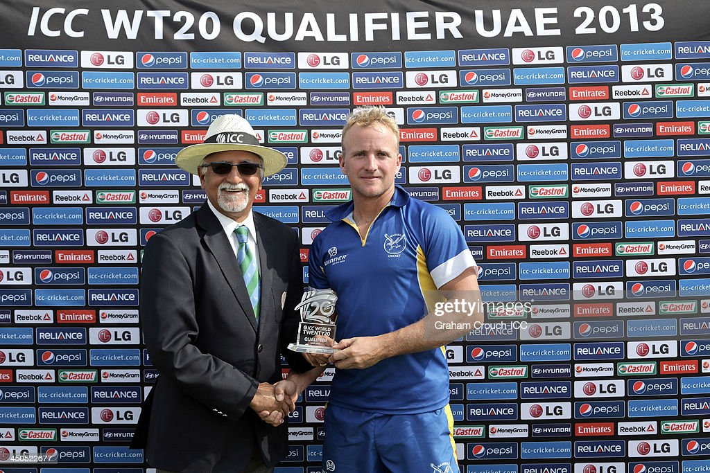 Match referee Dev Govindjee presents the man of the match award to Craig Williams of Namibia after his performance in the Namibia v Italy match at the ICC World Twenty20 Qualifiers at the Zayed Cricket Stadium on November 19, 2013 in Abu Dhabi, United Arab Emirates.