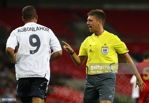 Match Referee Gianluca Rocchi warns England's Gabriel Agbonlahor
