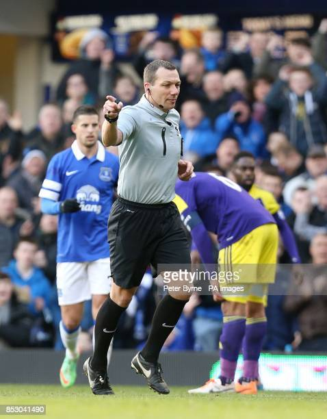 Match referee Kevin Friend awards a penalty after Everton's Steven Naismith is fouled by Swansea City's Ashley Richards