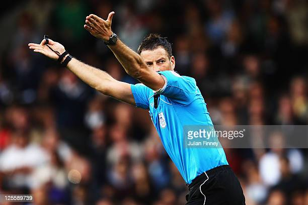 Match referee Mark Clattenburg is seen during the Barclays Premier League match between Fulham and Manchester City at Craven Cottage on September 18...