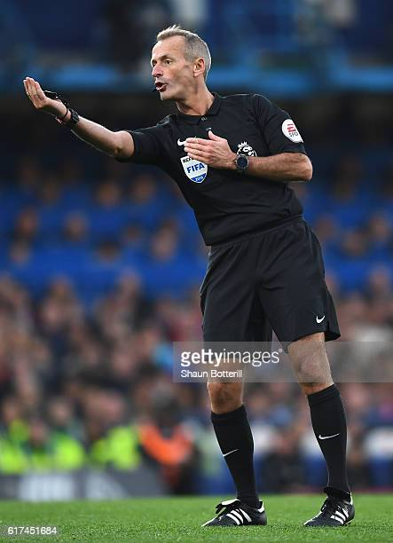 Match Referee Martin Atkinson reacts during the Premier League match between Chelsea and Manchester United at Stamford Bridge on October 23 2016 in...