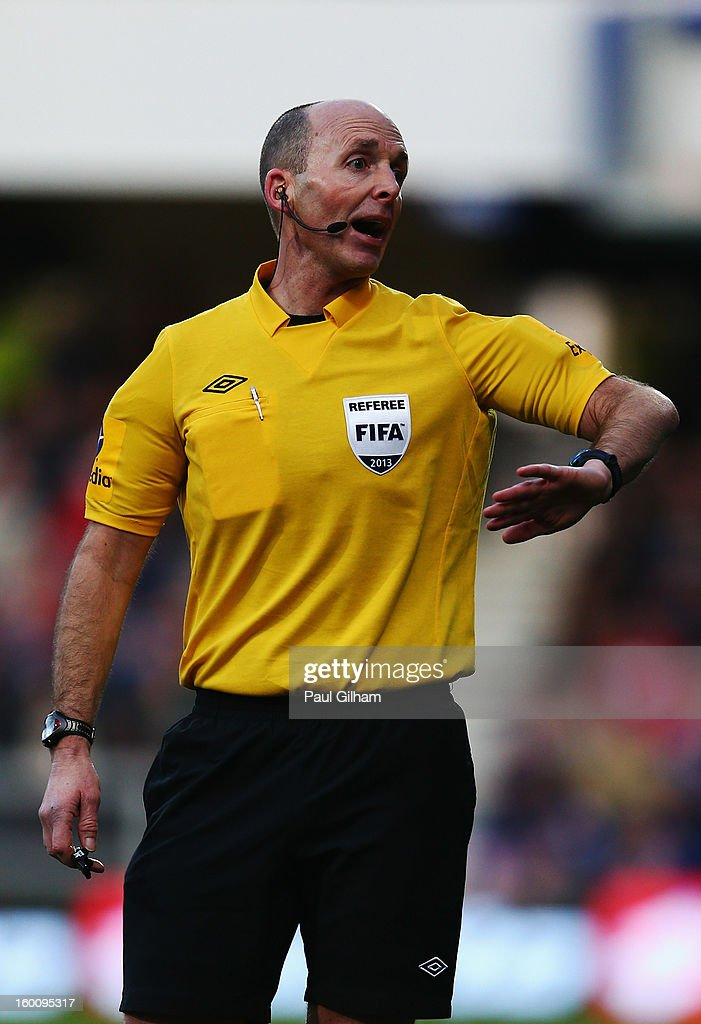 Match referee Mike Dean is seen during the FA Cup with Budweiser Fourth Round match between Queens Park Rangers and Milton Keynes Dons at Loftus Road on January 26, 2013 in London, England.