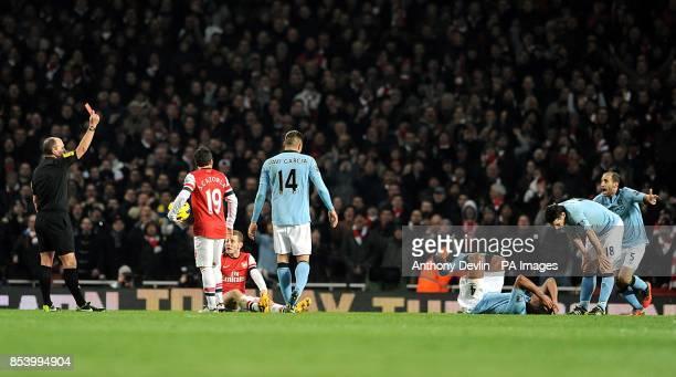 Match referee Mike Dean sends off Manchester City's Vincent Kompany