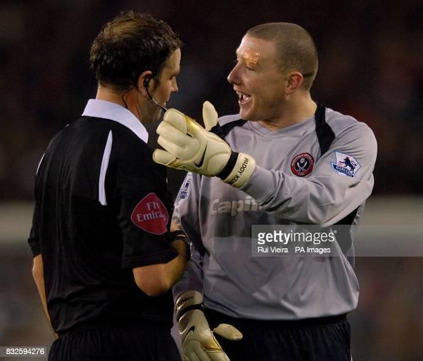 Match referee Mr M Clattenburg talks to Sheffield United's Patrick Kenny