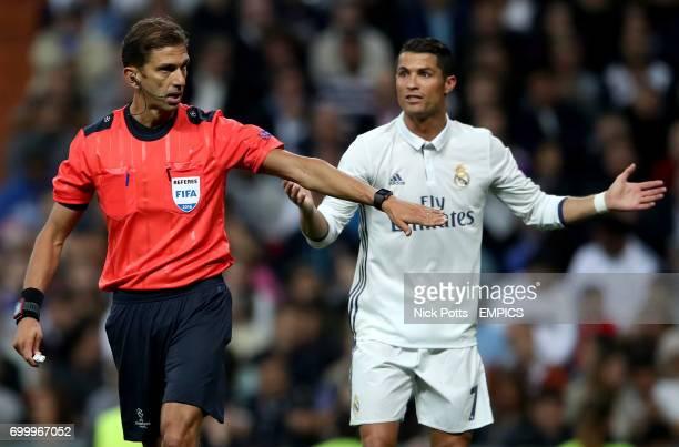 Match referee Paolo Tagliavento and Real Madrid's Cristiano Ronaldo