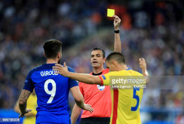 Match referee Viktor Kassai books France's Olivier Giroud