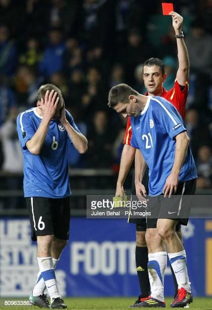 Match referee Viktor Kassai sends off Estonia's Andrei Stepanov