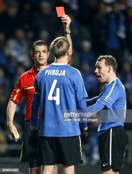 Match referee Viktor Kassai sends off Estonia's Raio Piiroja after a second bookable offence