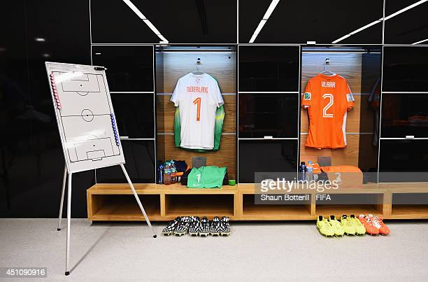 Match shirts worn by players of the Netherlands hang in the dressing room prior to the 2014 FIFA World Cup Brazil Group B match between Netherlands...