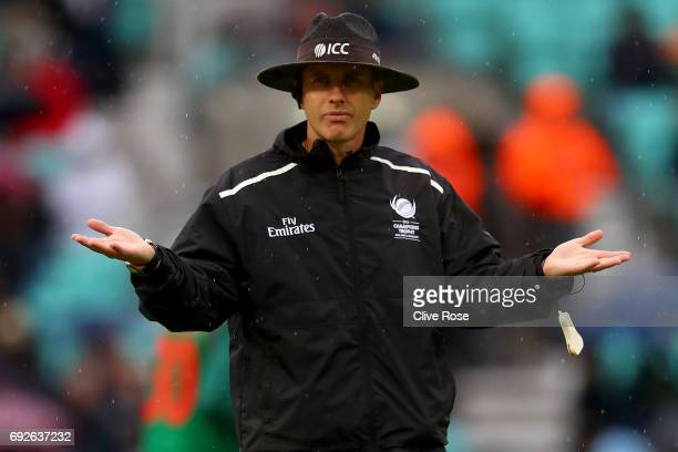 Match Umpire Chris Gaffaney calls a halt to play as rain falls during the ICC Champions trophy cricket match between Australia and Bangladesh at The...