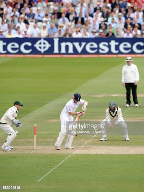 Match Umpire Daryl Harper looks on as England's Ian Bell plays a defensive shot while South Africa's wicket keeper Mark Boucher and Hashim Amla...