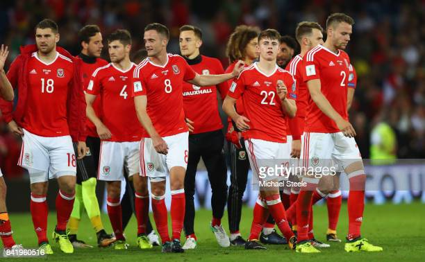 Match winner Ben Woodburn of Wales celebrates victory with team mates after the FIFA 2018 World Cup Qualifier between Wales and Austria at Cardiff...