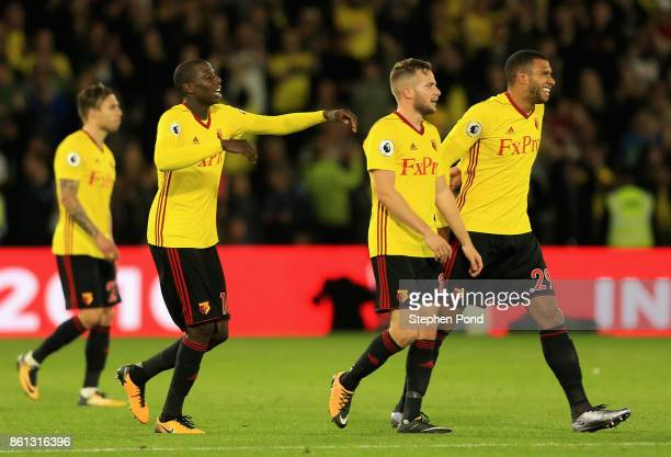 Match winning goal scorerTom Cleverley of Watford celebrates victory with team mates after the Premier League match between Watford and Arsenal at...