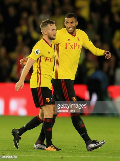 Match winning goal scorerTom Cleverley of Watford celebrates victory with team mate Etienne Capoue after the Premier League match between Watford and...
