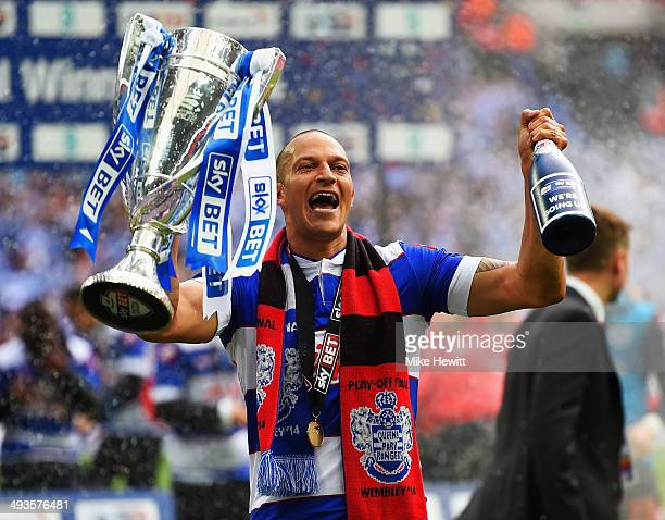 Match winning goalscorer Bobby Zamora of Queens Park Rangers celebrates with the winners trophy following his sides victory during the Sky Bet...