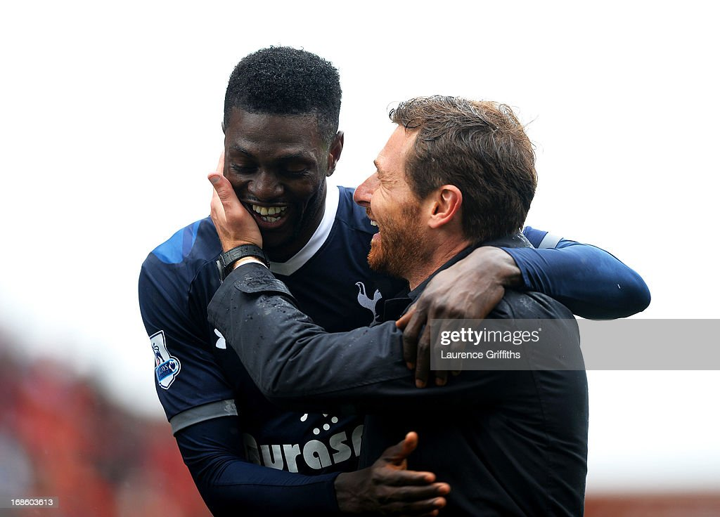Match winning goalscorer Emmanuel Adebayor is congratulated by Spurs manager Andre Villas-Boas following the final whistle during the Barclays Premier League match between Stoke City and Tottenham Hotspur at Britannia Stadium on May 12, 2013 in Stoke on Trent, England.