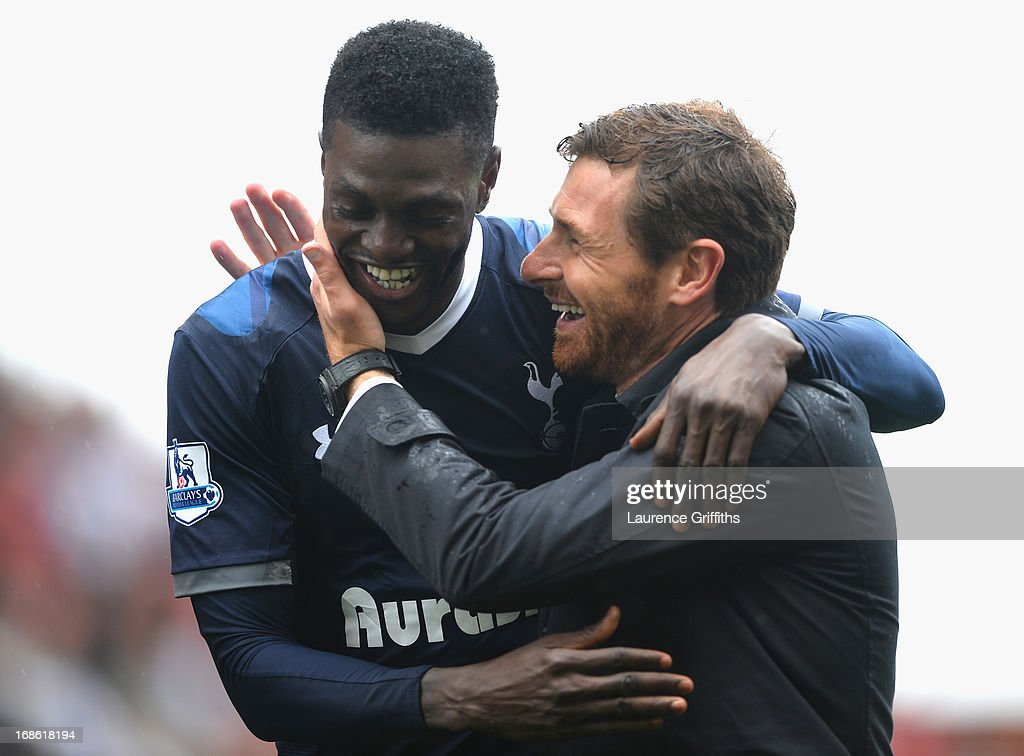 Match winning goalscorer <a gi-track='captionPersonalityLinkClicked' href=/galleries/search?phrase=Emmanuel+Adebayor&family=editorial&specificpeople=484018 ng-click='$event.stopPropagation()'>Emmanuel Adebayor</a> is congratulated by Spurs manager Andre Villas-Boas following the final whistle during the Barclays Premier League match between Stoke City and Tottenham Hotspur at Britannia Stadium on May 12, 2013 in Stoke on Trent, England.