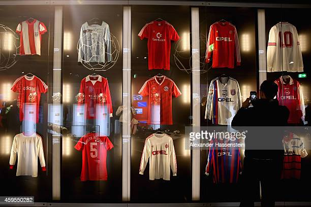 Match worn jerseys of Bayern Muenchen players are displayed at the FC Bayern Muenchen Erlebniswelt Museum at Allianz Arena on November 23 2014 in...