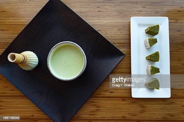 Matcha Green Tea Latte and Matcha Green Tea Mini Baum are displayed at Glaze the Baum Cake Shoppe in Denver CO May 14 2013 Entrepreneur Heather...