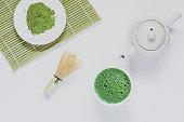 Matcha green tea on white wood