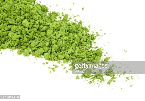 Matcha green tea spilt over the white surface