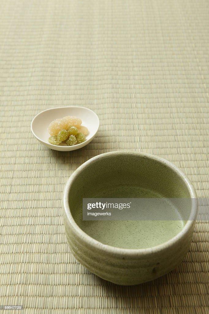 Matcha (Japanese powdered green tea) on tatami, close-up  : Stock Photo