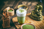 Still life with Japanese matcha accessories and matcha tea latte in glass