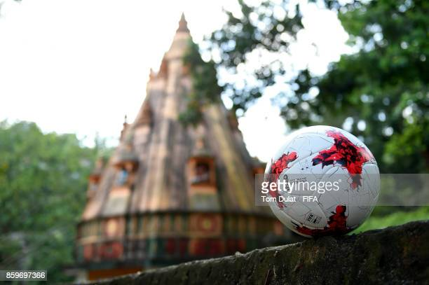 A matchball is pictured with a temple in the background during the FIFA U17 World Cup India 2017 tournament on October 10 2017 in Guwahati India