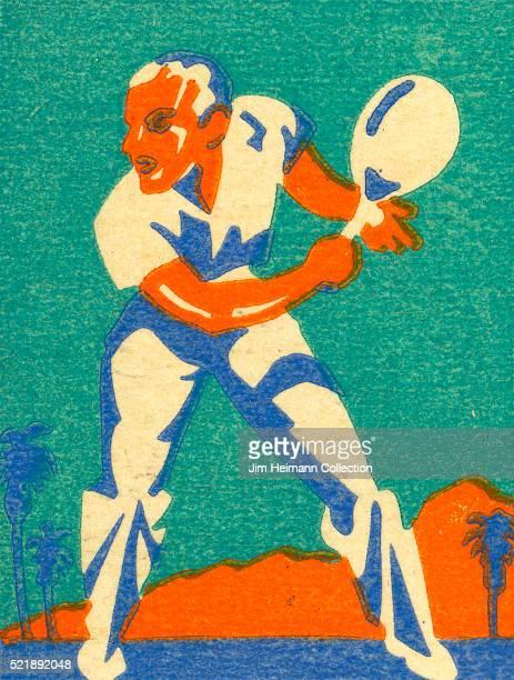 Matchbook image of a man in pants and a polo shirt getting ready to hit a tennis ball with a backhand stroke as palm trees and hills loom in the...